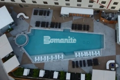 This pool deck features the Bomanite Alloy Exposed Aggregate System and the design is comprised of various geometric shapes that were colored with Bomanite Nickel Gray and Gobi Desert coloring to create contrast and accentuate the aesthetic at the Tulsa Hard Rock Hotel & Casino.