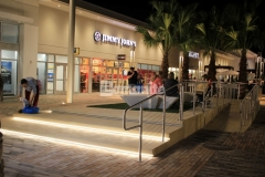 This step plaza and handicap ramp at the Tanger Outlets Daytona features Bomanite Alloy Exposed Aggregate decorative concrete that was installed to add a unique, reflective element that complements the beach aesthetic.
