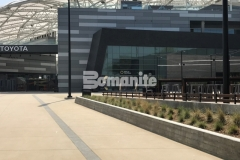 Bomanite Alloy was incorporated into the Bomanite Sandscape Texture walkways at LAFC Stadium and these contrasting bands of decorative concrete serve as line formations that direct fans into the stadium.