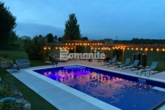 This Antique White and Slate Gray Bomanite Revealed decorative concrete was the perfect choice to create decorative concrete pool decking with durability and slip-resistance, while enhancing the design aesthetic with unique details like mirror glass and decorative sawcuts.