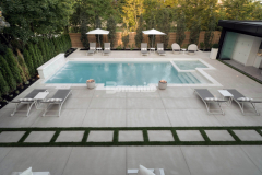 This outdoor living space was built for recreation and relaxation and features Bomanite Sandscape Refined decorative concrete, which was chosen because the process involves specialized concrete mix designs and advanced application procedures that showcase the fine aggregate and provide a distinct and durable architectural concrete finish.