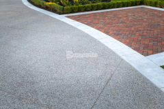 The Silver Award for Best Bomanite Exposed Aggregate Project was presented to our associate Bomanite Toronto for their skillful installation of Bomanite Sandscape Texture to create this beautiful and durable decorative concrete driveway that perfectly complements the home's exterior.