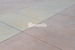 Sandscape Texture by Bomanite was expertly designed and installed here in three colors to add variation to the design while creating consistency through texture for a stunning courtyard hardscape that is seamless across the various gathering spaces.