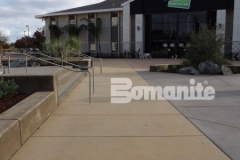 Bomanite Sandscape Texture was installed here to create a distinctively beautiful decorative concrete hardscape that is well-balanced and consistent to provide a cohesive design feel between the multi-use gathering spaces.