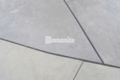 I love the modern, contemporary design aesthetic that was created here by incorporating these saw cuts into the Bomanite Sandscape Refined Antico decorative concrete.