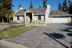Our associate Heritage Bomanite used Bomanite Imprint Systems to transform the front and back yards of this Fresno, California residence, creating a decorative concrete driveway, walkways, and back patio that feature the English Sidewalk Slate Bomacron pattern and enhance the cozy cobblestone cottage design.