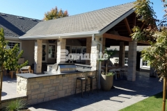 This backyard space features Bomanite Bomacron English Sidewalk Slate imprinted concrete and the complexity of color achieved by using Bomanite Sand Color Hardener and Bomanite French Gray Release Agent really draws out the clean lines and exterior stonework at this home.