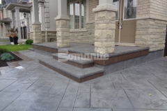 Bomanite Bomacron Yorkshire Stone stamped concrete is the perfect addition to this home's exterior, enhancing the aesthetic appearance while providing long-lasting durability that will withstand decades of use.