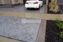 The Bomanite Bomacron Yorkshire Stone imprint pattern was utilized here to create custom detail in the decorative concrete driveway and steps and the Bomanite Shale Gray and Brownstone Color Hardeners add a beautiful, cohesive element to the exterior that enhances the charm and character.