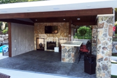 Bomanite imprinted concrete was expertly installed here by our colleague, Concrete Arts, to create a distinctive, decorative concrete flooring surface, using an integral gray color for the base and then stamping it with the Bomacron Slate Texture pattern to create this cozy cabana space.