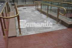Bomanite Bomacron Medium Ashlar Slate stamped concrete was installed here to create a pedestrian bridge and wheelchair access ramps and this durable concrete surface adds a beautiful decorative element to this functional design.